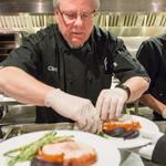 Chef preparing plates onsite